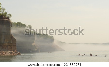 Kayakers in mist at Pictured Rocks National Lakeshore
