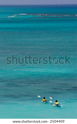Kayakers on blue caribbean sea
