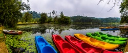 Kayaking at Karlad Lake Wayanad best water adventure park in Kerala travel and tourism concept image beautiful green scenery with boating