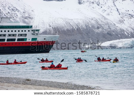 Kayaking at Magdalenafjorden with cruise ship in background, Spitsbergen, Svalbard, Norway, Europe, artic summer
