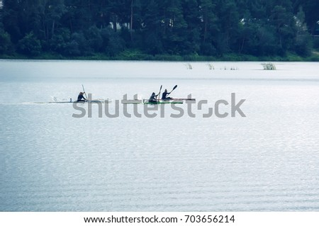 Kayaking competitions on the lake. competitions on rowing on open water #703656214