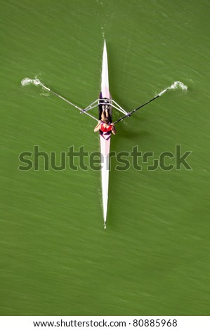 Kayaking down the river, young man rowing in kayak down the river - stock photo