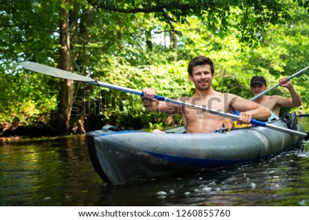 Kayaking. Friends in kayak with oars. Two men in canoe. People in boat. Active summer vacation #1260855760