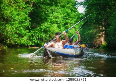 Kayaking in boat. Men rowing canoes. Rafting on river #1288022761