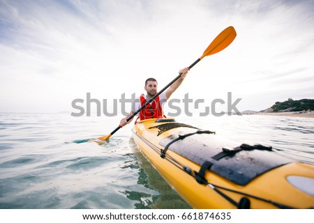 Shutterstock Kayaking. Man paddling a kayak. Concept for adventure, travel, action, lifestyle
