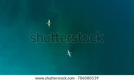 Kayaking on a lake aerial view