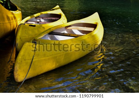 Kayaking on peaceful calm water/ Yellow kayak at beautiful green river/ Conceptual image of sport and recreation #1190799901