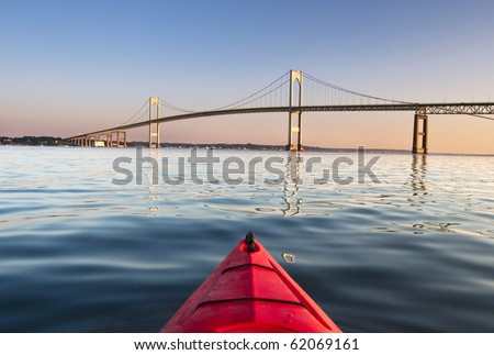 Kayaking towards The Pell Bridge at sunrise in Narragansett Bay off Newport,RI