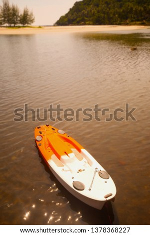 Kayaks and canoes in the lake