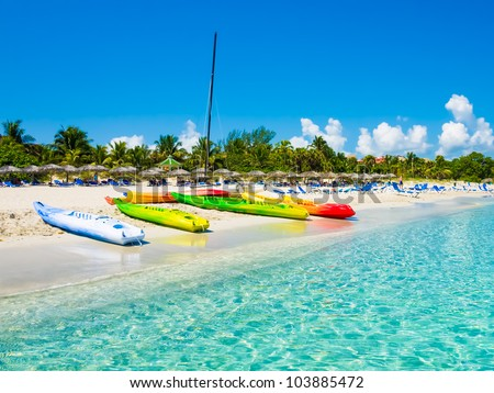 Kayaks and sailing boats on the beautiful beach of Varadero in Cuba (image taken from the sea)