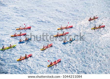 Kayaks. Big group of people kanoeing in the sea. People kayaking in the ocean.