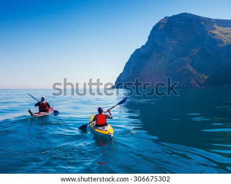 kayaks. couple kanoeing in the...