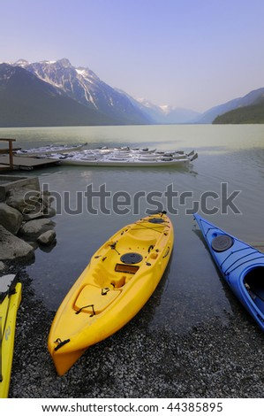 kayaks dock at a lake in Haines, Alaska
