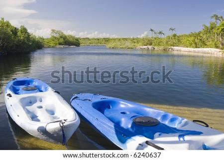 Kayaks on the dock at a calm lake