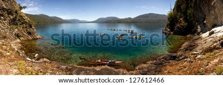 Kayaks on the lake in south patagonia.