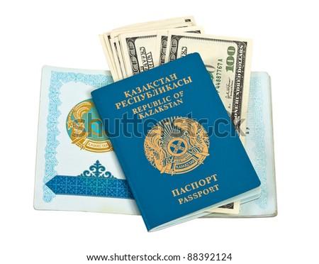 Kazakhstan passport and money isolated on white background