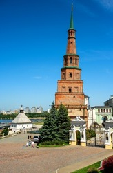 Kazan Kremlin in summer, Tatarstan, Russia. This place is tourist attraction of Kazan. View of leaning Suyumbike Tower and entrance to President Residence. Historical landmarks in Kazan city center.
