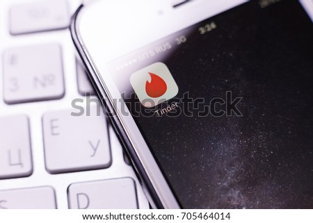 Kazan Russia 07.08.2016: iphone 5s with Tinder app logo on screen and apple keyboard. An illustrative editorial image