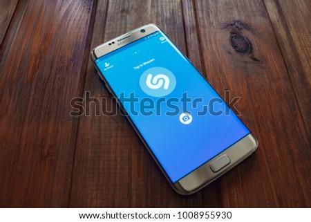 Kazan, Russian Federation - Sep 15, 2017: Samsung s7 Green with music service Shazam on the screen.  #1008955930