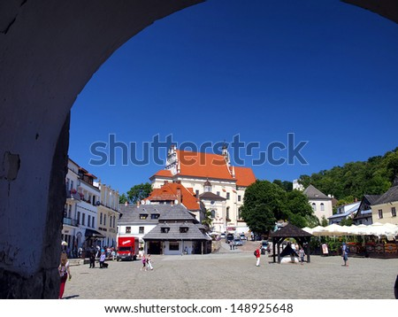 KAZIMIERZ DOLNY, POLAND - JUNE 19: Church. John the Baptist and St. Bartholomew - Parish Church located on the market square in Kazimierz Dolny, Poland June 19, 2013
