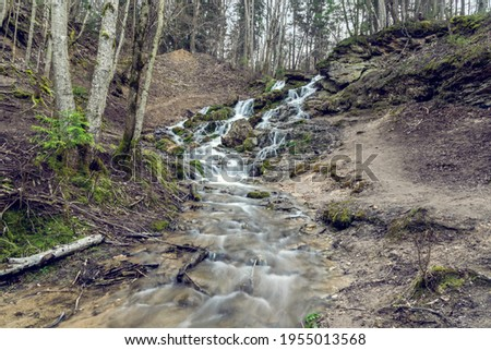 Kazu grava waterfall on the forest river in Latvia at spring Foto stock ©