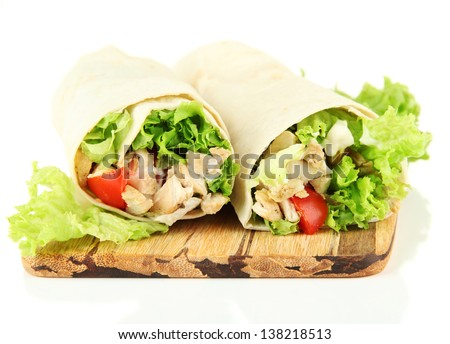 Kebab - grilled meat and vegetables, on wooden board, isolated on white