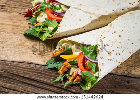Kebab in a pancake with vegetables and chicken