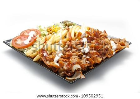 Kebab lamb meat with fries and salad
