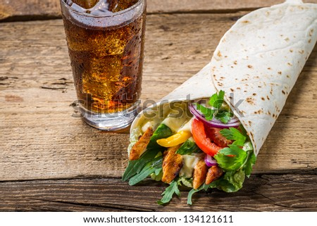Kebab made of vegetables and chicken served with cold cola