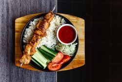 kebab with rice cucumbers, tomatoes and onions