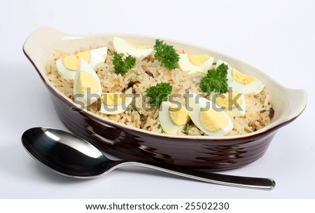 Kedgeree, flakes of smoked herring baked with rice, milk, stock, pepper and parsley, and served with hard-boiled eggs. A Scottish dish that was a particular favourite in British India.