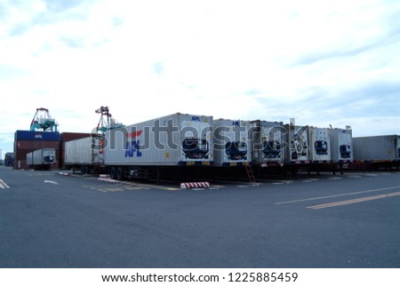 Keelung, Taiwan - September 16, 2004: Customs exports of many containers stacked. #1225885459