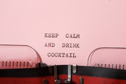 Keep calm and drink cocktail phrase written with a typewriter.