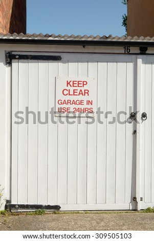 Keep Clear Garage in Use 24 Hours sign - on garage door