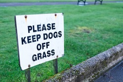 Keep dogs off grass sign