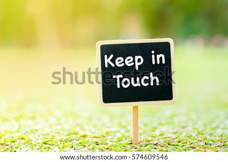 Keep in Touch word on Black Board attach on the ground.