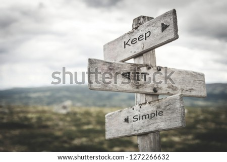 Keep it simple signpost. Nature, adventure, message, text, quote concept. #1272266632