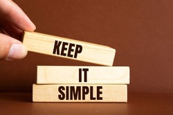 Keep it simple - word from wooden blocks with letters, to make something easy, keep it simple concept
