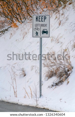 Keep Left and Keep Right sign against snowy slope