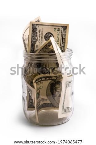 Keep money in glass jar - banka but not bank. Saving money or deposit program concept Stok fotoğraf ©