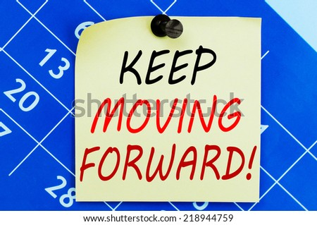 Keep Moving Forward ! Motivational message text written on note paper