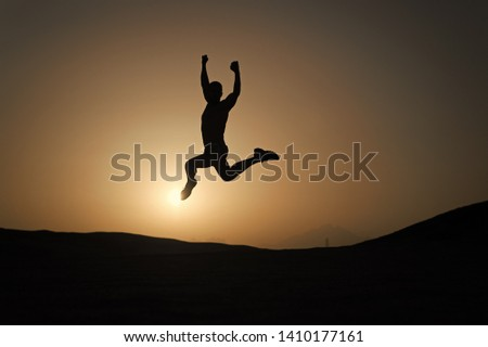 Keep moving. Silhouette man motion jump in front of sunset sky background. Daily motivation. Healthy lifestyle personal achievements goals and success. Future success depends on your efforts now.