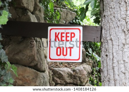 Keep Out Sign on wooden post
