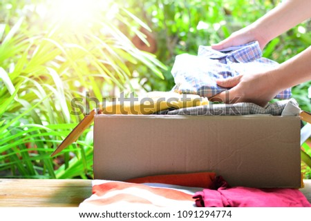 keep the clothes in box for concept donation and reuse recycle