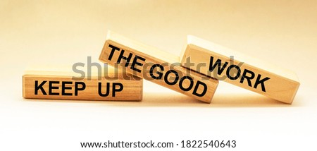 Keep up the good work, text is written on wooden blocks Foto d'archivio ©