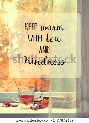 keep warm with tea and kindness. inspiration quote. autumn season background. tea cup, leaves, acorns, boooks on windowsill. Beautiful fall time. cozy autumn home concept