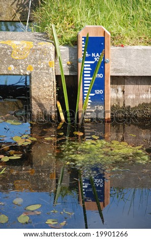keeping an eye on the water below sea level with a ruler in the Netherlands