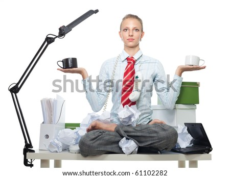 Keeping balance between god and evil in work - woman sitting on work table