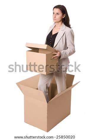 keeping carton box businesswoman standing in carton box - stock photo