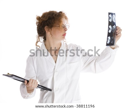 keeping clipboard female doctor looking at tomography brain